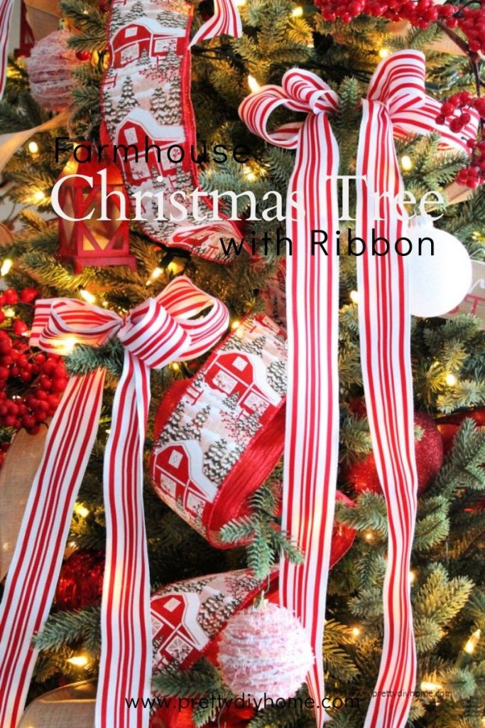 A farmhouse Christmas tree decorated in red and white with lots of ribbon and DIY ornament.