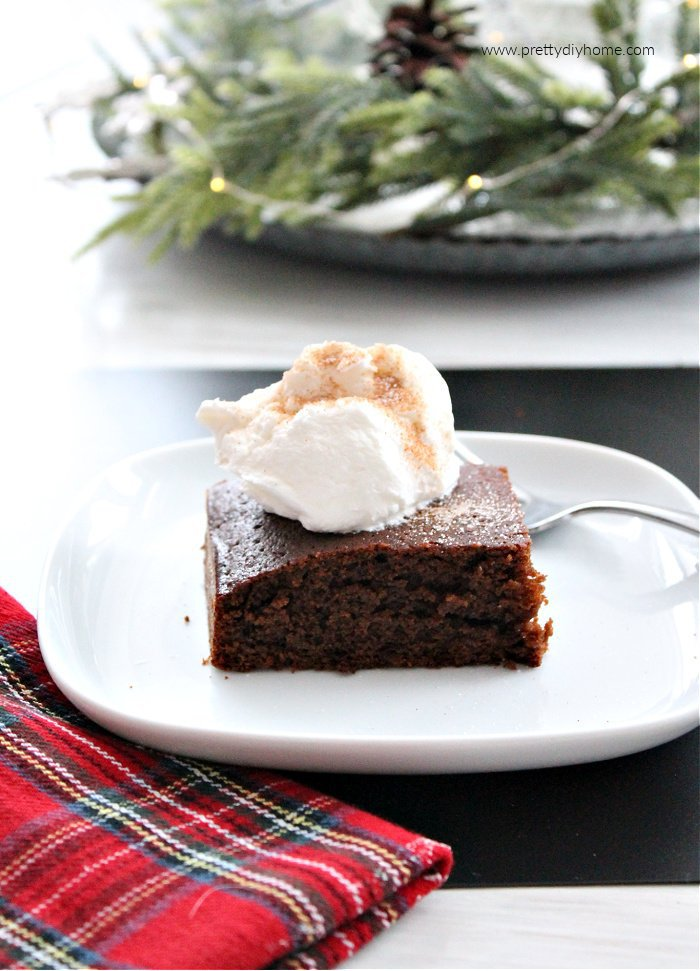 Homemade Gingerbread cake for Christmas dessert, served with brown sugar sauce and fresh whipped cream.