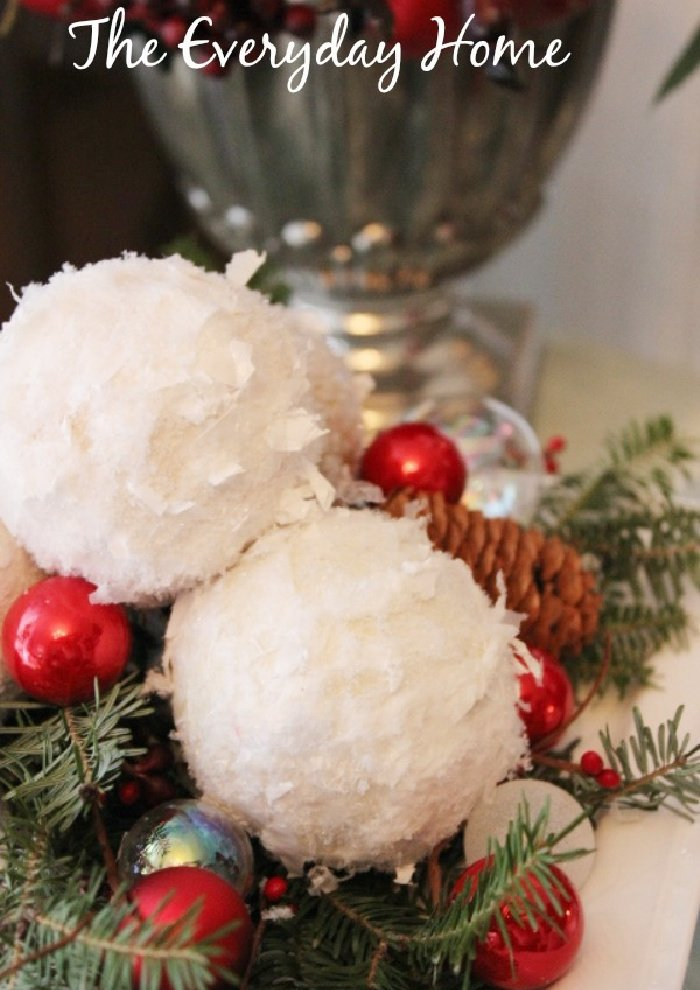 A Christmas centerpiece in traditional Christmas colours including homemade snowballs