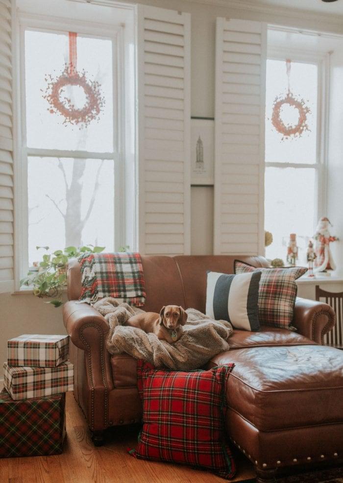 Christmas plaid decorated living room with plaid tartan ribbon wreaths.