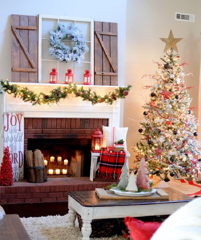Bright an cheerful Christmas livingroom with a mantel and flocked Christmas tree  with tartan Christmas decorations.