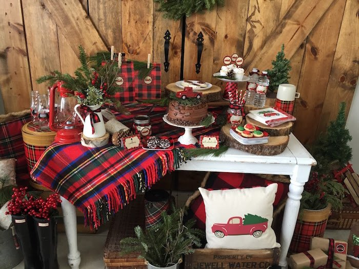 A buffet set up for Christmas featuring tartan plaid accessories, napkins and thermos.