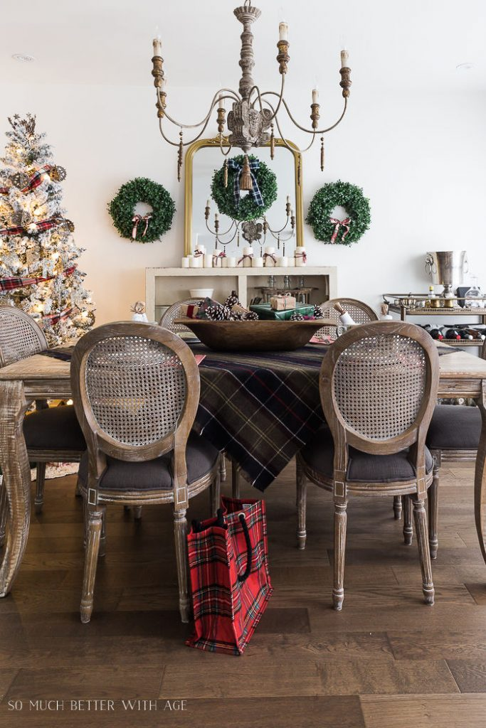 A dining room decorated for Christmas was Tartan decorations, as a table cloth, ribbon on the tree and on wreaths.