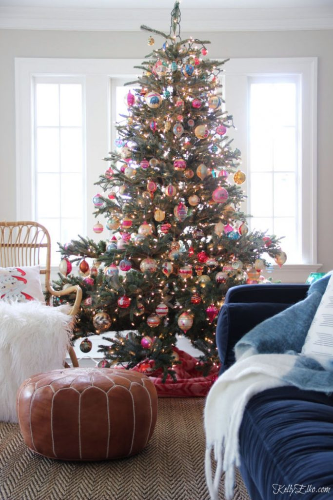 Large traditional Christmas tree decorated with Shiny Brite vintage ornaments.