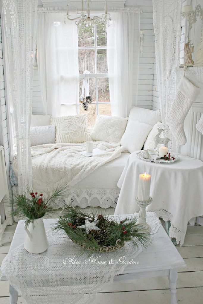 Cozy cottage living room in all white Christmas decor with a shabby chic feel.