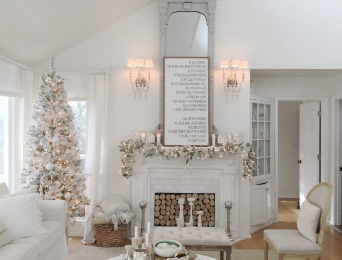 Bright white Living room with white Christmas sign over a white Christmas mantel and White Christmas tree