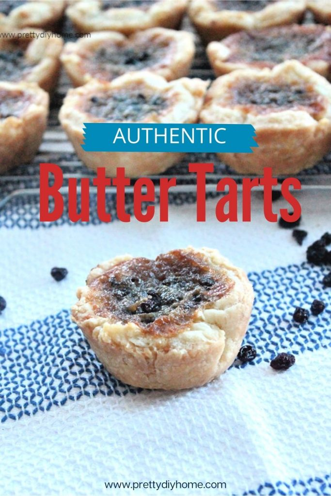 Classic butter tarts just out of the oven with a light pastry crust, currants and a brown sugar vanilla filling.