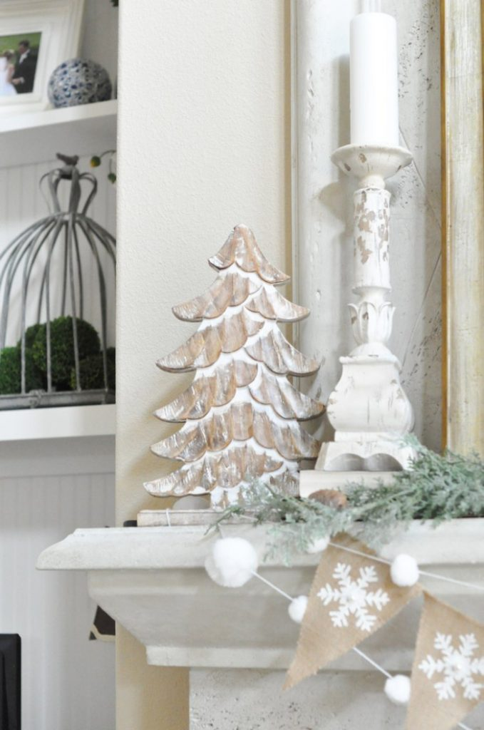 A white wooden tree, candlestick,