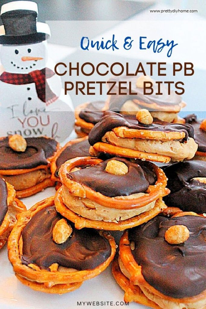 A plate of homemade peanut butter pretzel treats covered in chocolate with a peanut . There is a whiteon top