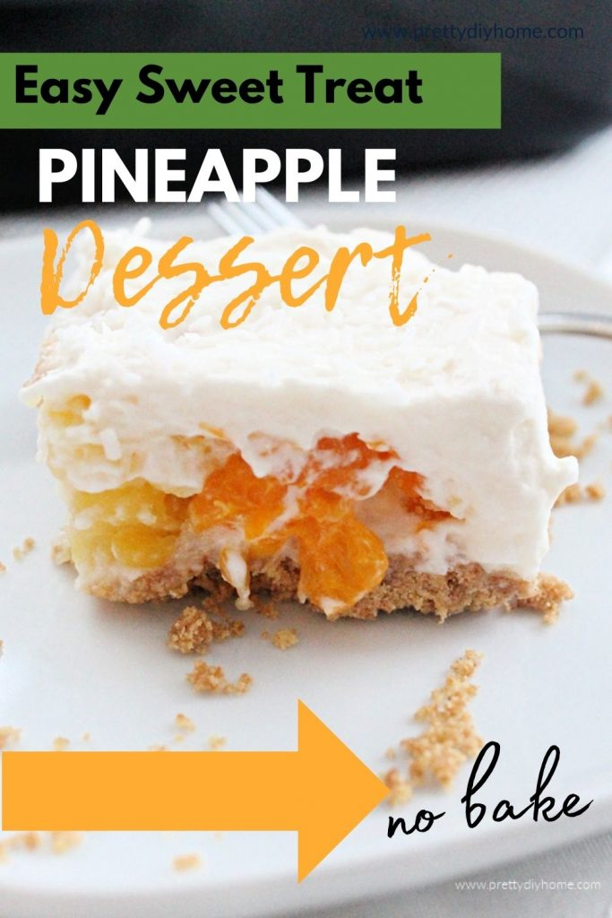 An Easy Sweet Treat with crushed pineapple and whipped cream, served in a large piece with mandarin oranges inside.
