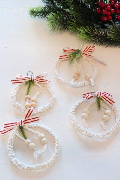 Four diy christmas mini wreaths for the Christmas tree in a farmhouse style.