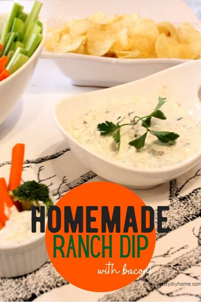 A large bowl of homemade ranch dip served with fresh cut up vegetables.