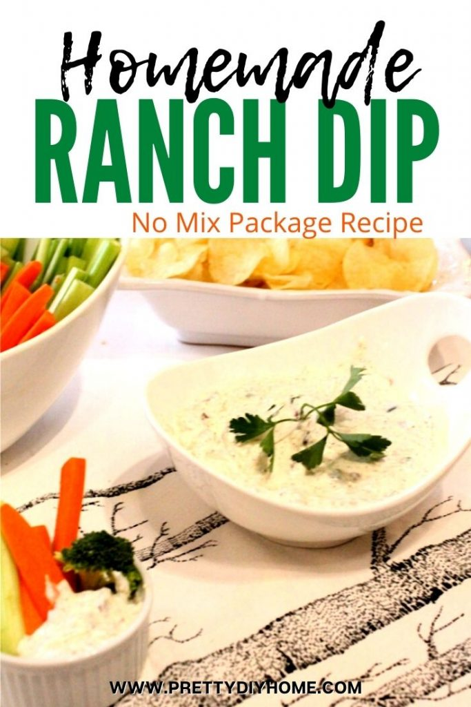Homemade ranch dip served with a bowl of fresh raw vegetables and a bowl of plain potato chips.