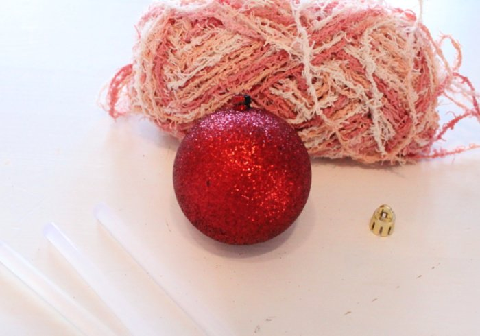 Supplies for making a homespun Christmas ornament including cotton wool, glue gun and dollar tree ornament.