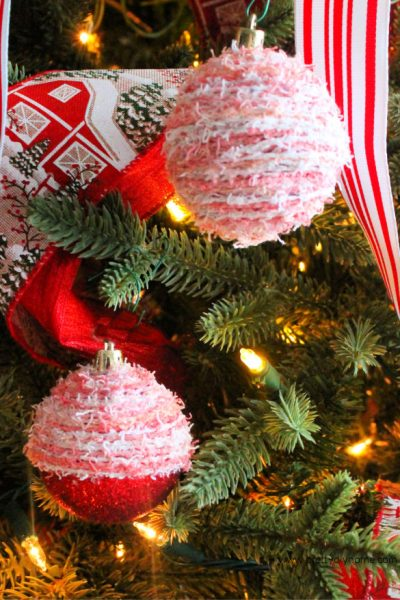An easy Christmas craft idea using wool and dollar store Christmas balls.
