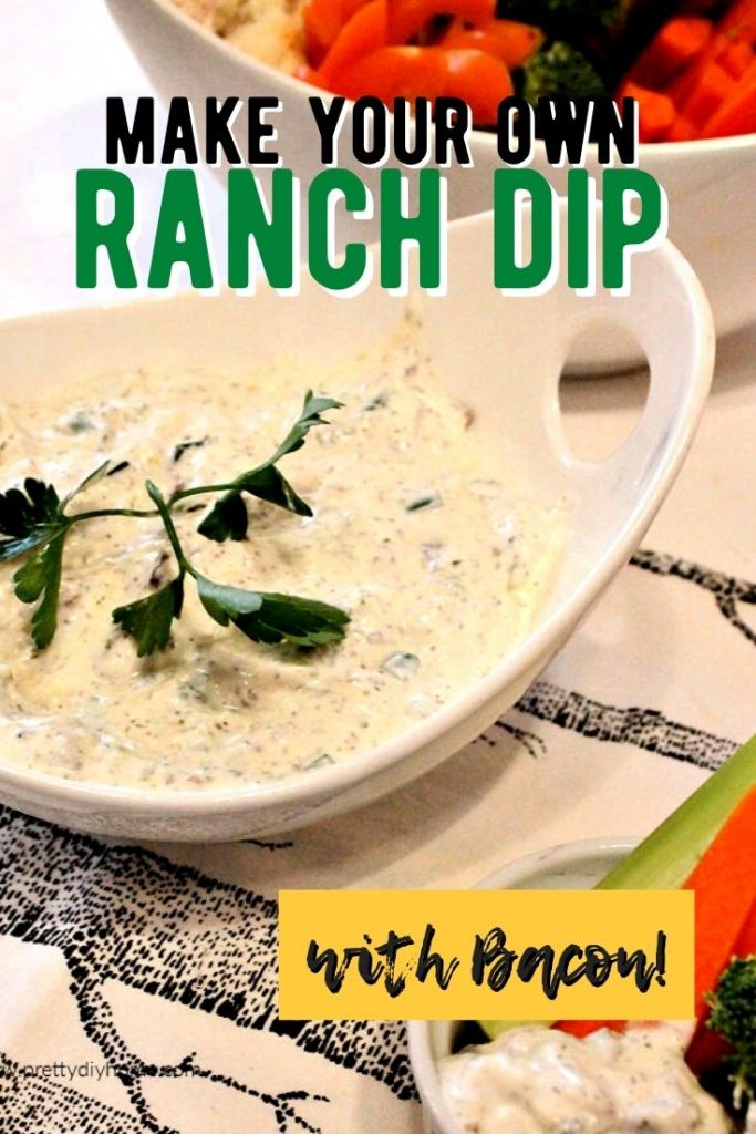 A large bowl of homemade bacon cheddar ranch dip, served with vegetables or potato chips.