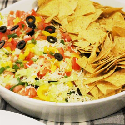Homemade Seven Layer Dip with Beans, salsa, cheese, vegetables, and sour cream