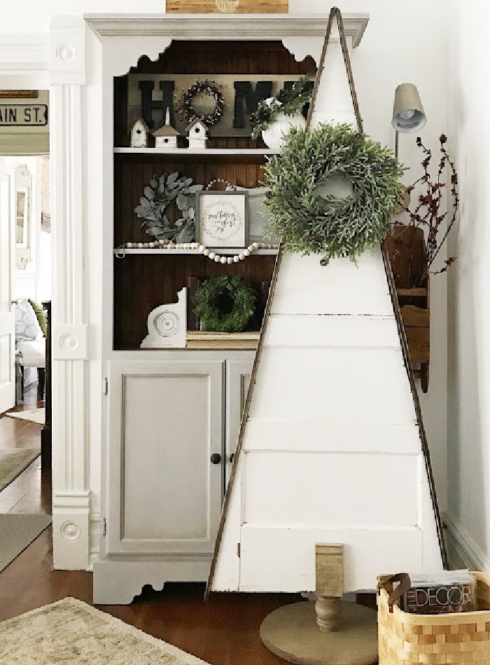 An old door made into a Christmas tree for Farmhouse Christmas decor idea