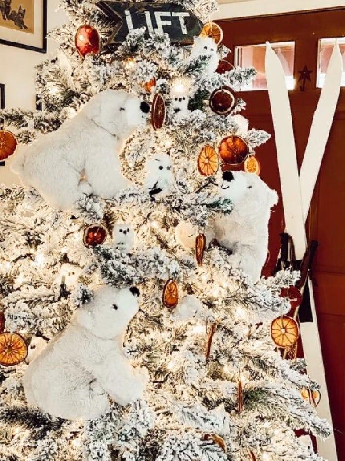 Rustic Christmas tree with large polar bear decorations. A unique Christmas home decor idea.