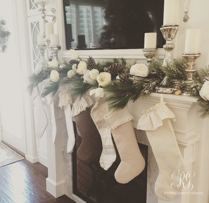 White Christmas mantel with white Christmas stockings and white roses