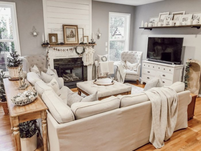 Cozy and comfortable living decorated in White for Christmas with cream throws.