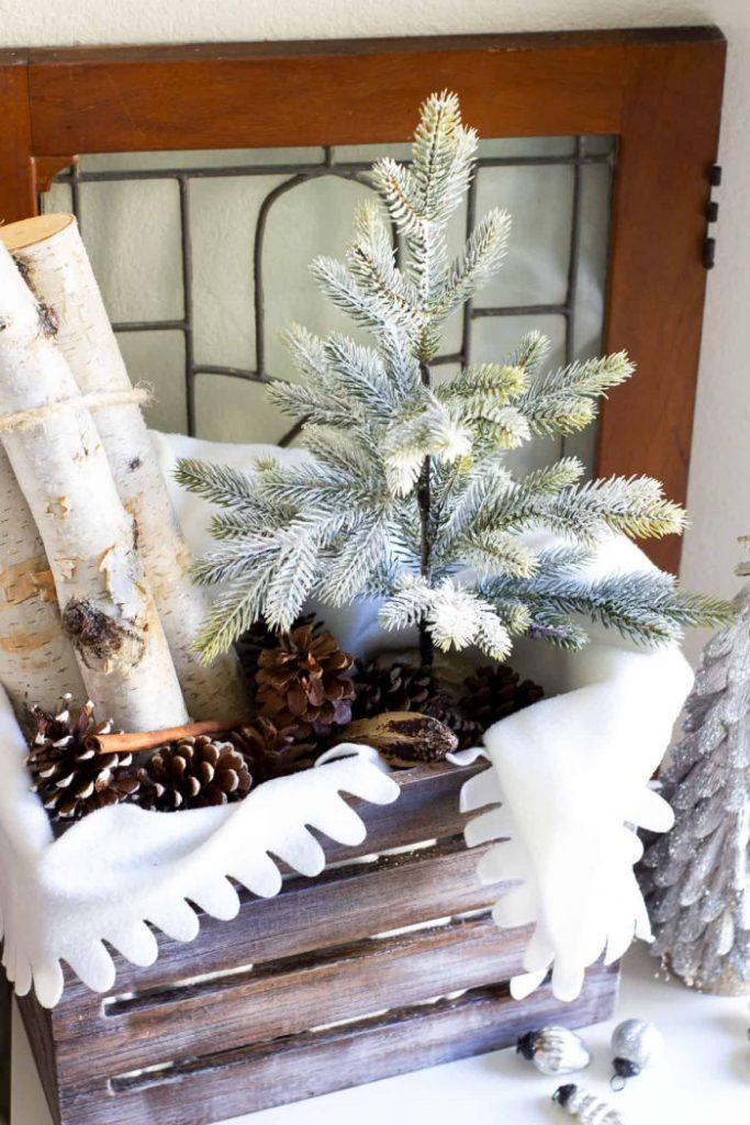Soft icy green Christmas ornaments with a flocked tree and pine cones. A Christmas decor tour for the holidays.