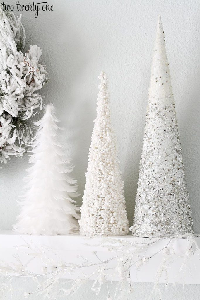 White cone Christmas trees in a Winter White Bedroom with lots of sparkles.