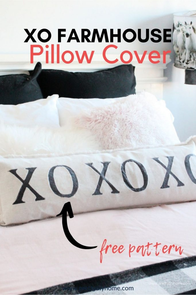 An appliqued pillow in cream with black XO lettering on the front made using a free pattern.