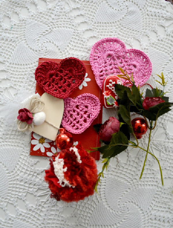 Handmade crocheted lace Valentines in pink red and white.