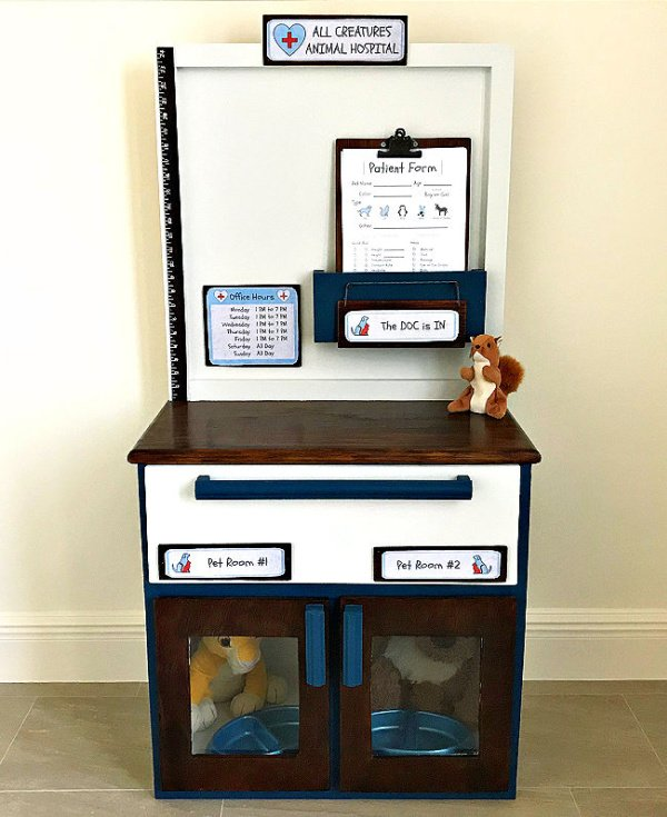 Handmade Pet clinic play area for children with an assortment of stuffed animals.