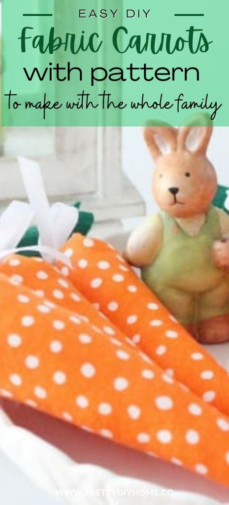 Three DIY fabric carrots made with orange polka dot fabric, white ribbon and green felt leaves. They rabbits are guarded by a cute ceramic Easter bunny.