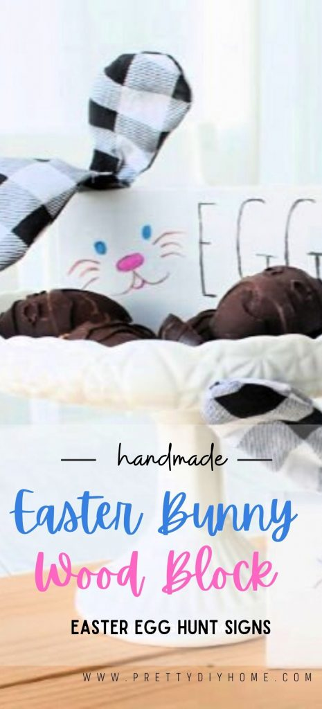 Cute wood block bunnies with buffalo plaid ears, Sitting in a dish of chocolate Easter eggs. The image text says handmade Easter Bunny Easter Egg Hunt Signs
