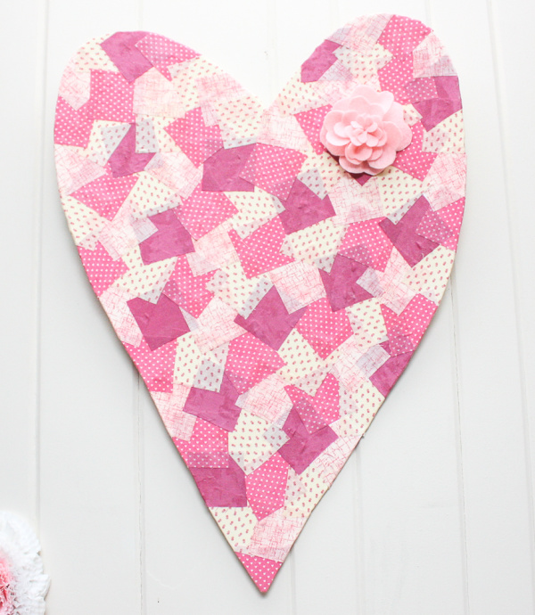 A pink fabric covered easy DIY Valentine quilt craft idea.
