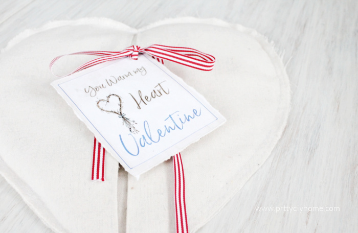 Valentine Heating Pad in a Farmhouse Style made with drop cloth, grain sack ribbon, and jasmine scented rice with essentials oils.