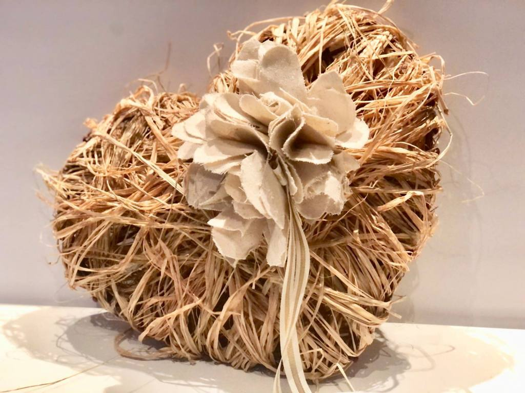 A cream raffia covered Valentine in a shabby chic style.
