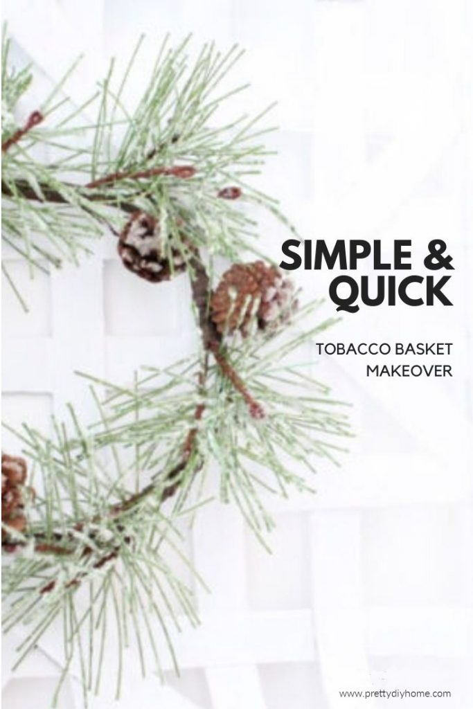 An ugly tobacco basket made over into a pretty winter tobacco basket wall hanging with white paint and a simplistic green wreath.