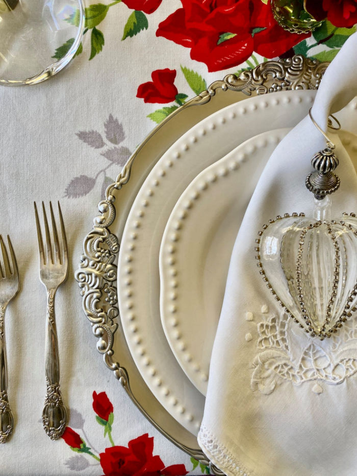 A silver, red and white table setting for Valentine's Dinner