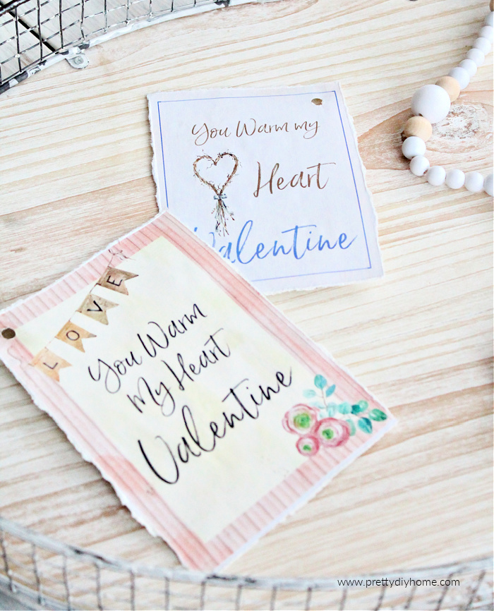Two free printable valentine cards one pink and one soft blue. Both say your warm my heart Valentine.