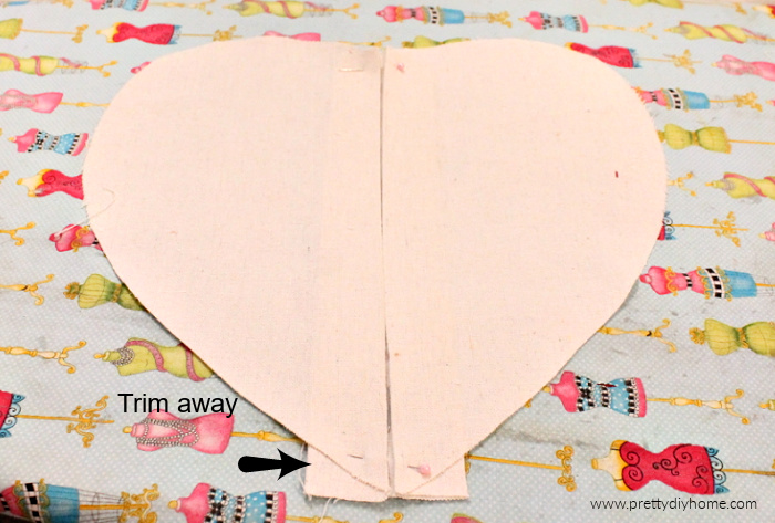 The front piece of a DIY valentine heating pad with a pleat in the front. It is made of drop cloth.