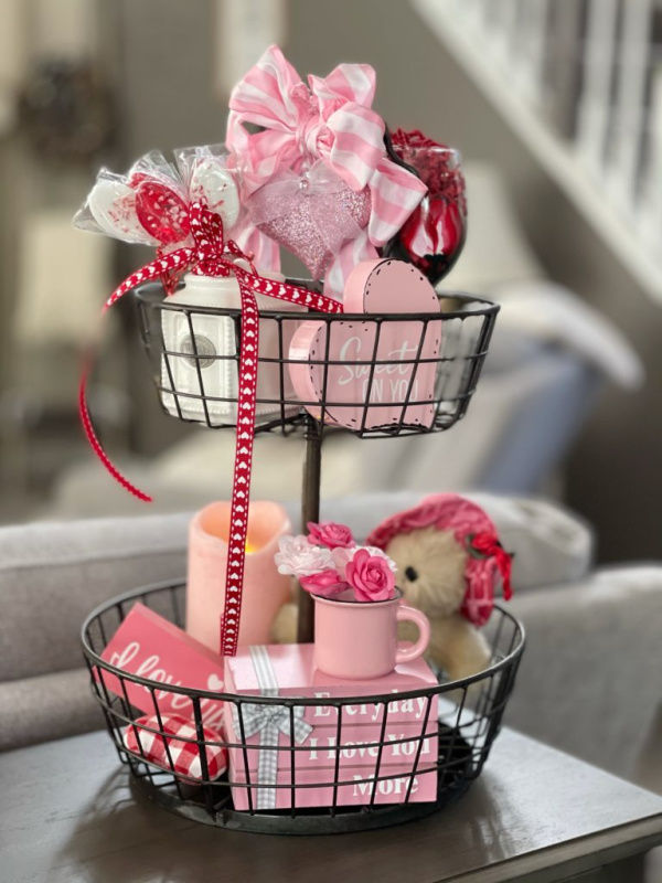 A simple two tiered tray decorated with pretty Valentines ornaments.