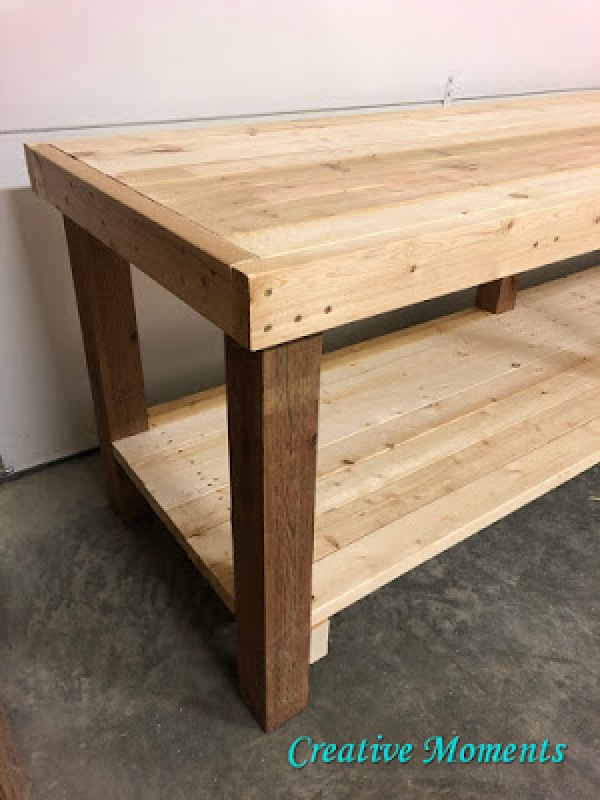 Large hand built table for the garage made with wood.