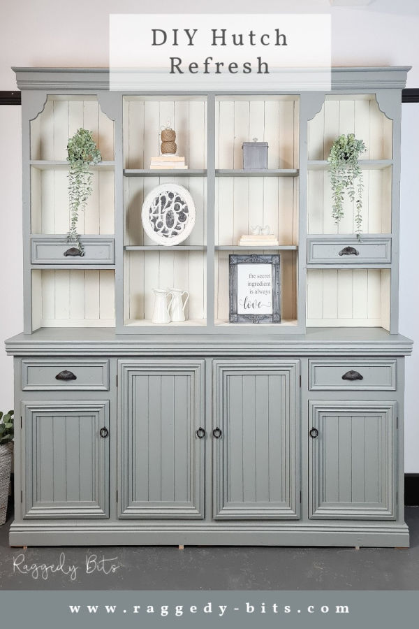 A large painted and refurbish cabinet, painted in grey with a cream coloured background.