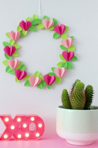 Pretty pink Valentine heart wreath made with paper.