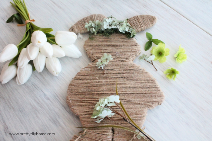 Removing stems from flowers so you just have the blossoms for decorating the twine Easter bunny.