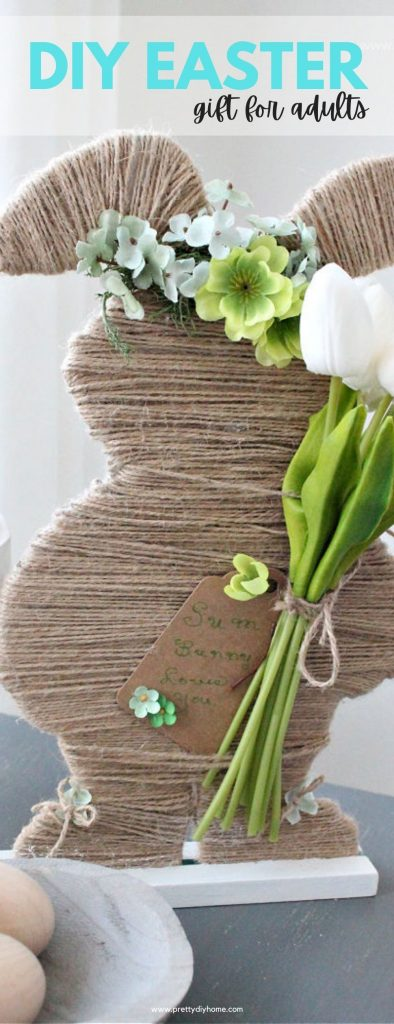 A twine covered Easter bunny with floral crown and faux tulips. An easy to make DIY Easter gift idea as their is a card that says Some Bunny Loves You.