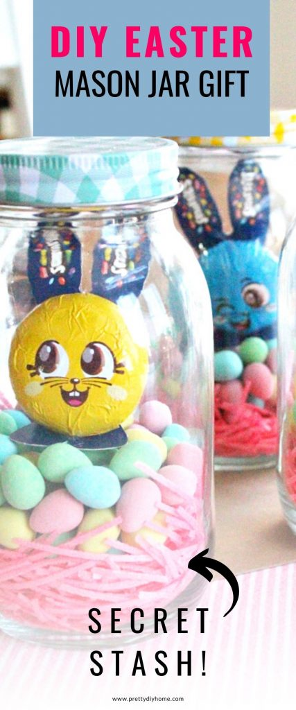 A DIY Easter mason jar gift idea with a checkered lid, bright pink Easter grass, colourful chocolate eggs and a Easter bunny. There is a money folded insider that you cannot see in the picture.