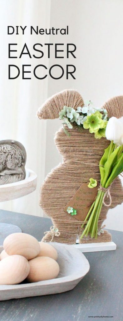 DIY farmhouse Easter decor with a handmade twine wrapped Easter bunny, wooden eggs, and a galvaized sheep on a white farmhouse tray.