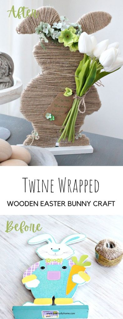A large twine wrapped Easter bunny holding faux white tulips. He is sitting on a table as part of a white, green and beige neutral farmhouse Easter decor arrangement.
