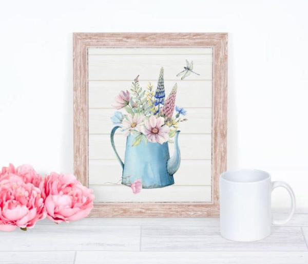 A spring printable download with an old tin pot and spring flowers.