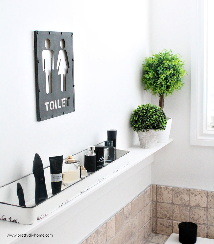 DIY Farmhouse shelf update with farmhouse decor, topiaries and black metal his and her bathroom sign.